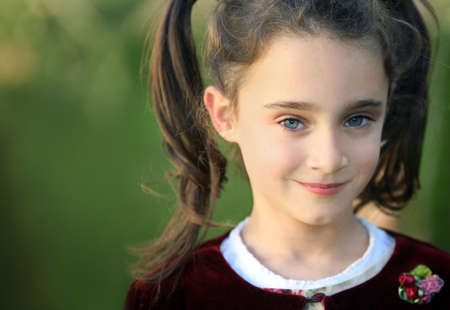 7 year old girl: A portrait of a 7 year old girl with blue eyes