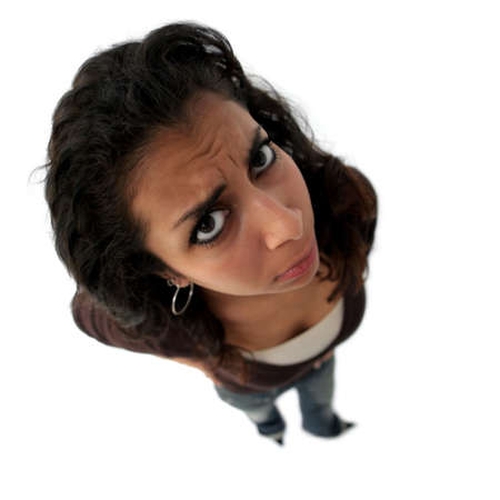 A teenage angry indian girl. The picture was taken with fisheye lens