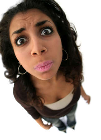 A teenage girl with a funny expression. The picture was taken with fisheye lens