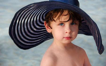 A cute little boy in a big hat photo