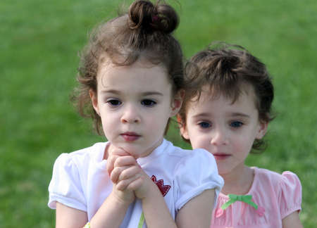 An outdoor portrait of two 4 year old girls