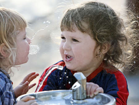Two cute brothers having fun outdoors photo