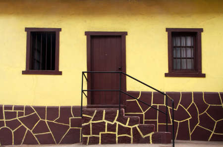 Yellow and brown house in Valparaiso, Chile photo