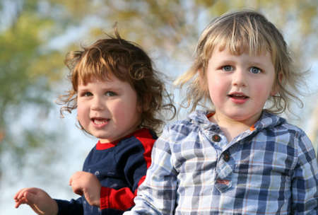 Two happy brothers having fun outdoors photo