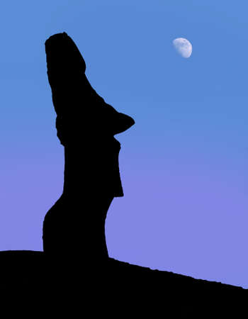 A silhouette of a stone statues on Easter Island