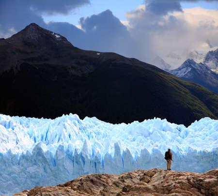 A man looking at Perito Moreno Glacier, Patagonia, Argentina Фото со стока