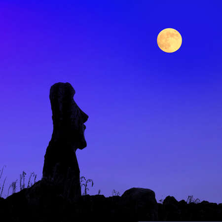 A silhouette of a stone statues on Easter Island at full moon Stok Fotoğraf