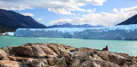 A woman looking at Perito Moreno Glacier, Patagonia, Argentina Stock Photo