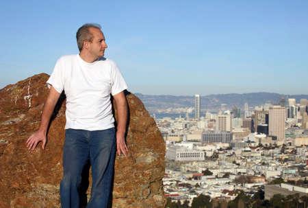 city living: A mature man enjoying the view of San Francisco