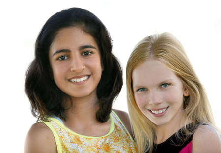 Two happy teen girls - indian and caucasian