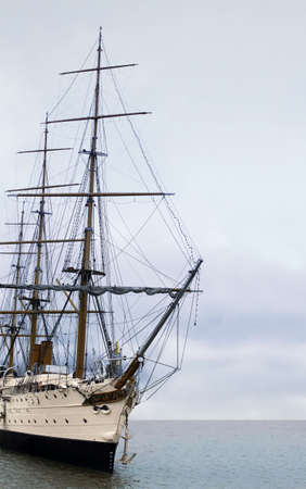 The vintage sailing ship in the ocean photo