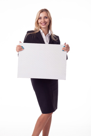 Blonde with long hair posing with white plate, pattern. For logo, advertising. Isolated photo on a white background for advertising. In a business black suit. Stock Photo