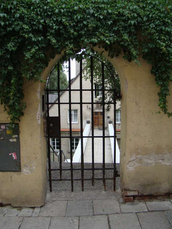 wicket gate: A wicket in the old town in Warsaw, Poland Editorial