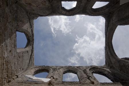 Open roof of ruined abbey church in vertical view