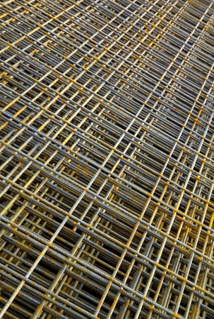 Stack of rusty reinforcing steel in diagonal view photo