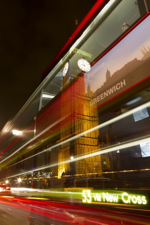 London, United Kingdom - March 27, 2011: Light trails of London double-decker bus 53 departing from bus stop at Big Ben