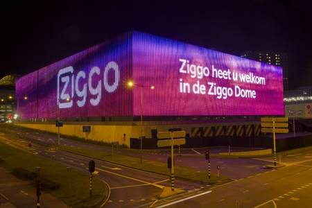 Amsterdam, Netherlands - September 2012: LED strips-lighted video screen facade of new Ziggo Dome concert hall Editorial