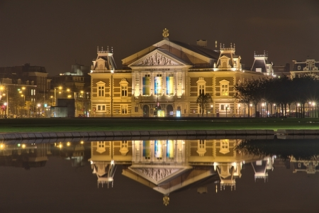 Amsterdam, Netherlands - October 17, 2011: Concert building / Concertgebouw reflected in pool at night Editorial