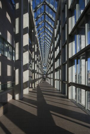 Canada, Ottawa, December 15, 2012 - Main hallway of National Gallery of Canada, pattern of windows, glass ceilings and granite construction, with deep perspective into vanishing point