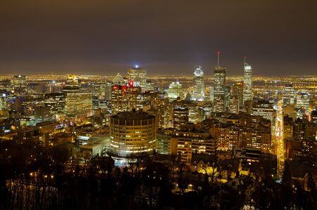 Canada, Montreal, December 14, 2012 - Night panorama over Downtown Montreal skyline with skyscrapers in winter, taken from Mont Royal
