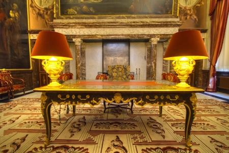 Amsterdam, the Netherlands, April 7, 2013: Desk and chair of abdication Queen Beatrix at Royal Palace Amsterdam Editorial