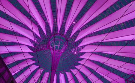 urban redevelopment: Modern purple illuminated roof of sails at Berlin Potsdamer Platz