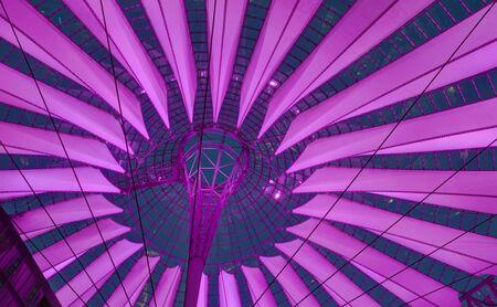 Modern purple illuminated roof of sails at Berlin Potsdamer Platz