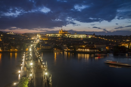 Charles Bridge and Prague Castle after thunderstorm in cloudy night Stock Photo