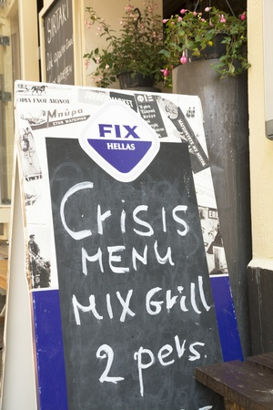 Greek restaurant in Utrecht, the Netherlands, offers a crisis menu at low price for two persons Editorial