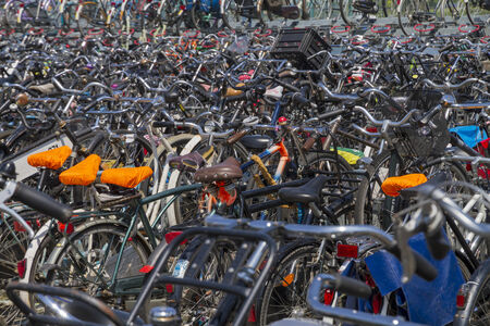 parked: Bicycle handlebars of large number of bicycles parked in Amsterdam Stock Photo