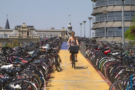 Bicyclist leaving highest level of Amsterdam cycle parking station