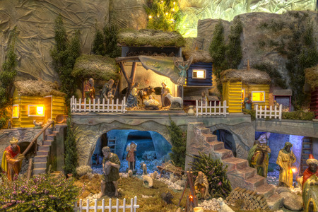 Nativity scene with two levels of norwegian houses Editorial