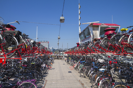 Fully utilized Amsterdam two-storey bicycle parking station on refurbished ferry boat Editorial