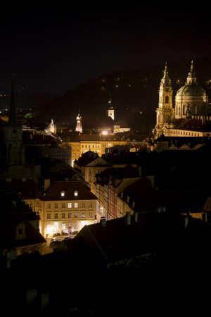 Prague streets at night  view over Lesser Town Mala Strana, an illuminated path along the Czech Senate towards the Saint Nicholas church Editorial