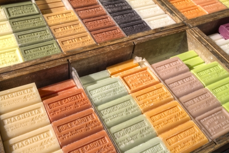 French soap bars with many colourful perfumes on market in Apt, Provence in wooden crates
