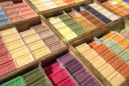 apt: French soap bars with many colourful perfumes on market in Apt, Provence in diagonal shot in wooden crates Editorial
