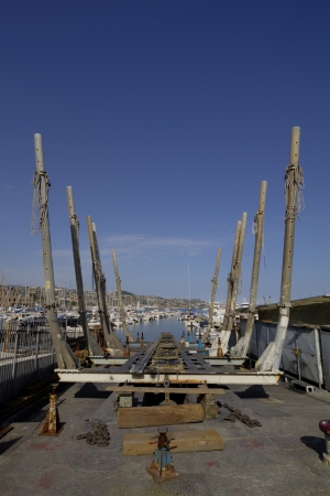 drydock: Empty drydock for fisher boats in old harbour of San Remo, Italy Stock Photo