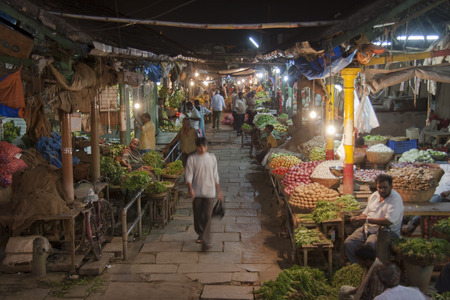 Indian market at night with stalls of green grocers in Devaraja market, Mysore, Karnakata, India