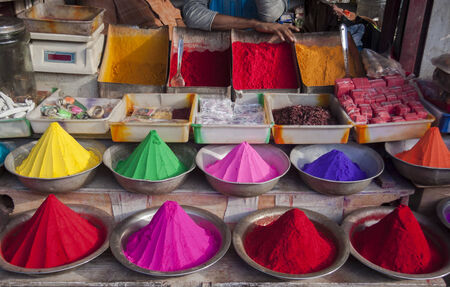 Bowls of bright, colorful paint powder at Devaraja market stall in Mysore, India