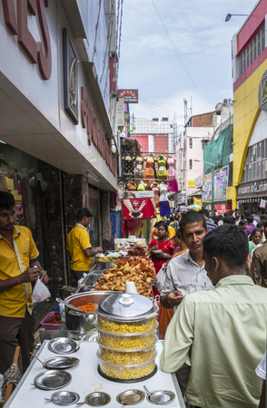 Food stalls in Indian shopping street with corn and fried Indian cuisine Editorial