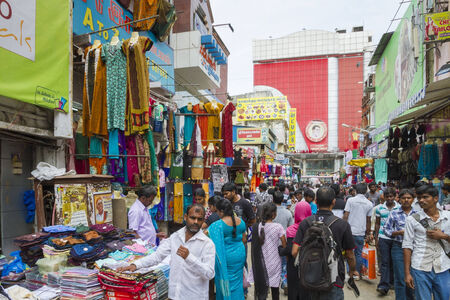 Very busy market street in Chennai, India with textile stalls Editorial