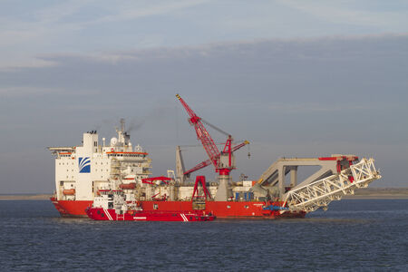 Pipelay vessel, dedicated to lay oil and gas pipes in shallow and deep waters, seeking refuge for bad weather at Marsdiep near Texel, joined with service vessel