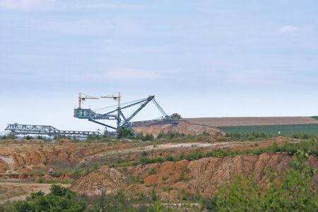 open pit: Lignite mining blade destroys farm field in open pit mine near Bogatynia, Poland
