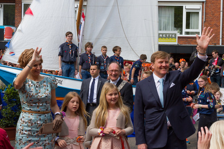 King Willem-Alexander, Queen Maxima of the Netherlands and two  princesses gently waving whilst visiting Amstelveen on the occasion of the first King Editorial