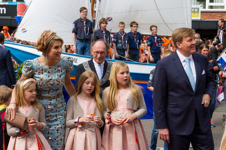 Dutch Royal Family, King Willem-Alexander, Queen Maxima and princesses Amalia, Alexia and Ariane, looking with interest at local community display in Amstelveen Editorial
