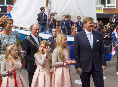 King Willem Alexander of the Netherlands gently smiling together with his wife Queen Maxima and three daughters, the young princesses