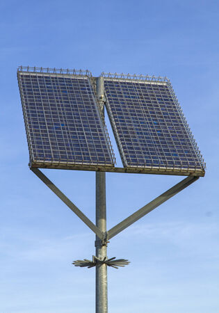 Solar panels with grid protection on pole, preventing theft and vandalism