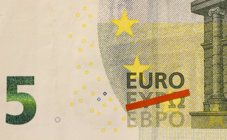symbolized: Greek exit of the Euro symbolized by red line crossing out Greek word for Euro on five euro banknote