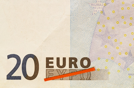greek alphabet: Grexit, Greece exiting the Euro visualized by red line crossing out Greek word for Euro on 20 Euro banknote Stock Photo