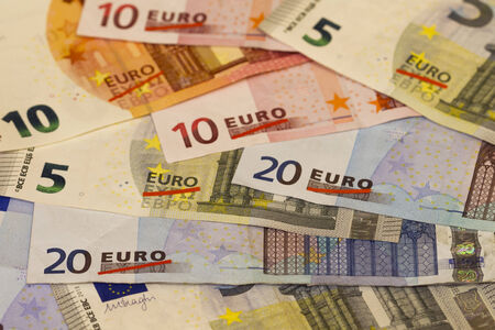 eurozone: Grexit, Greece exiting the Euro, depicted on various Euro banknotes: red line crosses out the Greek characters for Euro